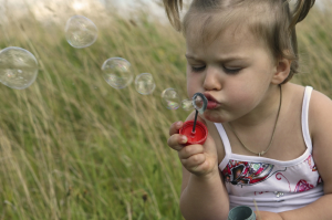 girl with blowing bubbles