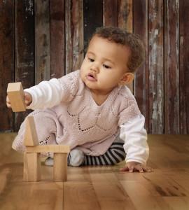 baby plays wooden blocks