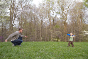 dad and child playing catch
