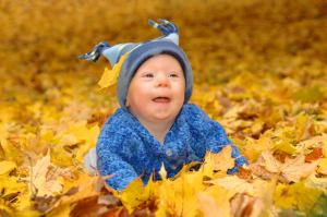 baby in the leaves