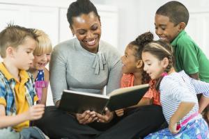 Teacher reading to preschool students