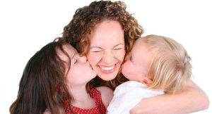 children kissing child care provider