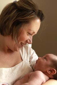 Mother smiling a infant