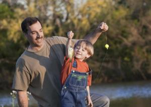 dad and young son fishing