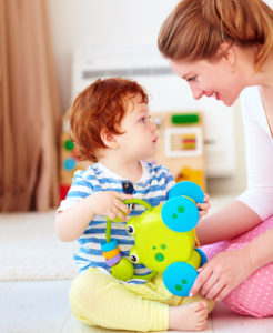 child care provider playing with child