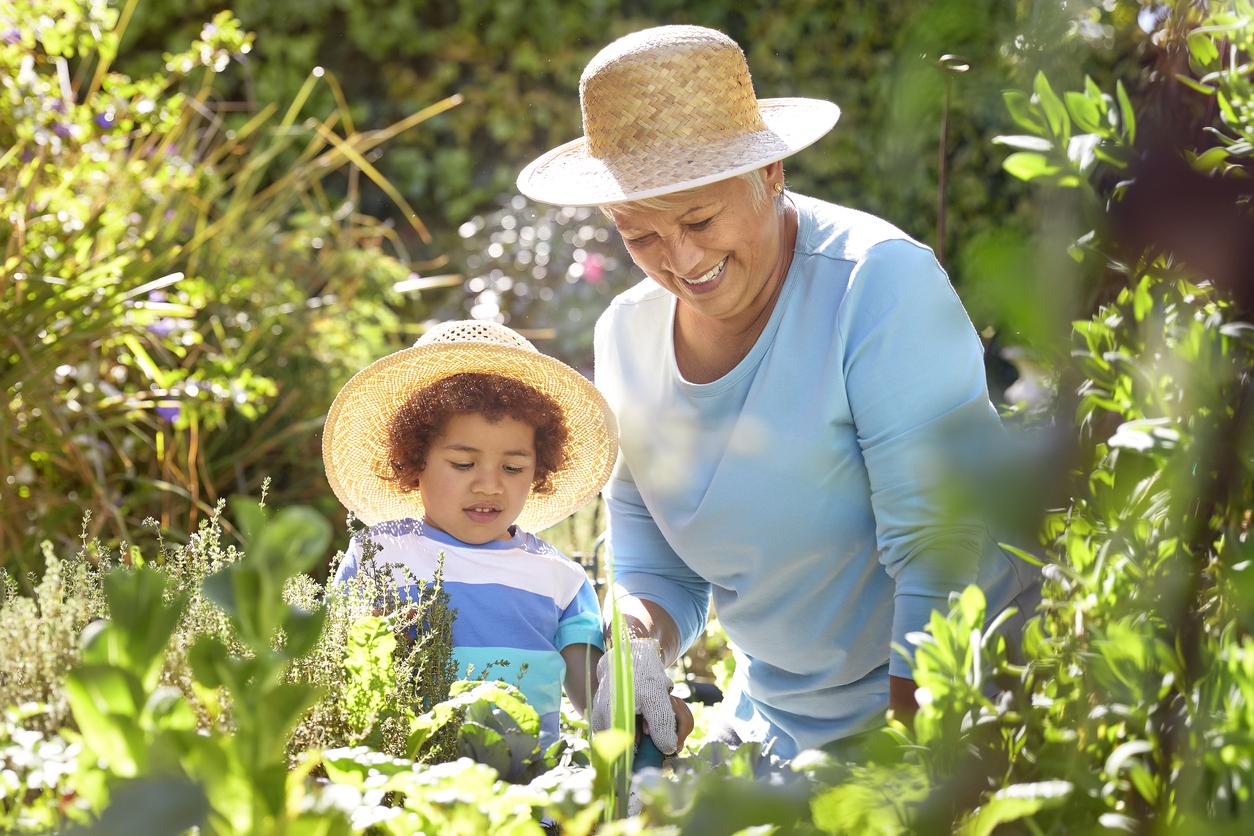 grandparent and child garden